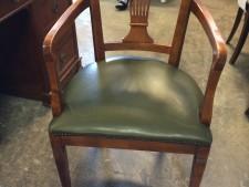 Sedia in legno e pelle usata a Treviso
